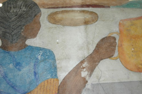 Here's a detail of the mural fragment on display from Haiti's Holy Trinity Cathedral.  It's from one of only 3 (out of 14) murals that survived the January 2010 earthquake.