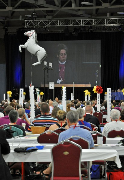 Deputations typically decorate their table poles--this horse balloon floats above the Diocese of Lexington's table.  Massachusetts is seated in the front row, too far from the press box to see what they've got going on.  We'll keep working on that scoop.  (ENS Photo:  Mary Frances Schjonberg)